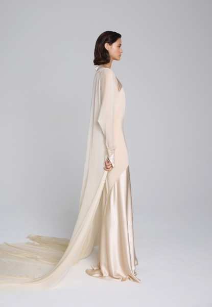 satin-trimmed gown and silk cape