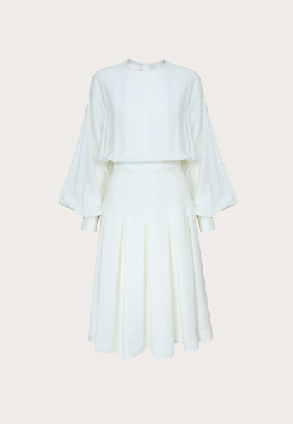puffed-sleeve silk blouse and pleated linen midi dress